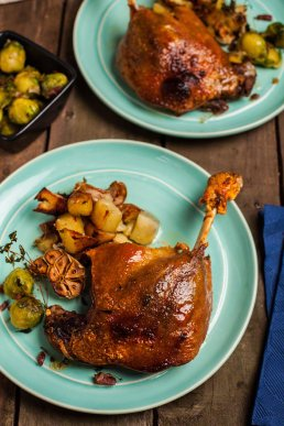 Photograph of plumb and juicy confit duck legs.