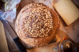 Photograph of freshly baked oath wholemeal bread.