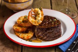 Photograph of delicious king prawn and fillet steak surf n' turf.