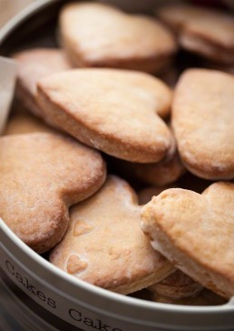 Photograph of freshly baked, heart-shaped biscuits.