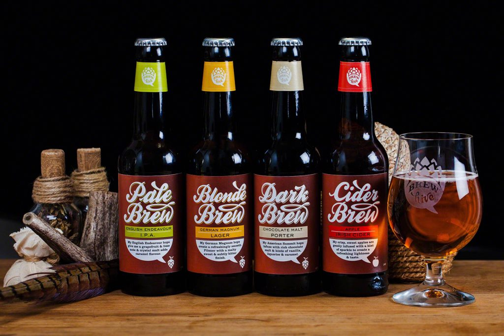 Product photograph of the Brew Hive beer and cider range with branded glass.