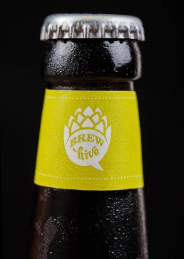 Photograph of an icy cold bottle of Brew Hive cider.
