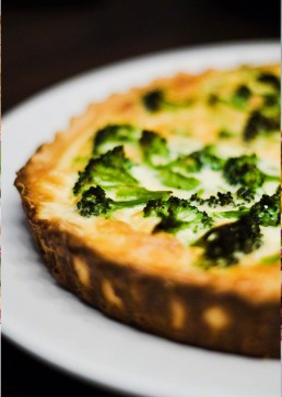 Photograph of a light and flavoursome broccoli tart.
