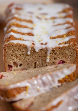 Photograph of fruit infused cake drizzled with sweet white icing.