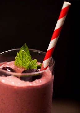 Photograph of freshly blended cherry smoothy.