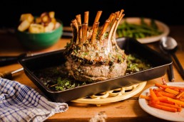 Photograph of a juicy lamb crown.