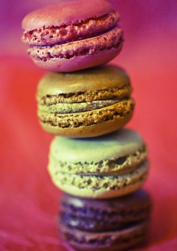 Photograph of colourful macaroons stacked on top of each other.