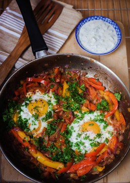 Photograph of delicious, tangy baked Mexican eggs.