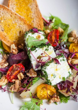 Photograph of a fine cheese salad.