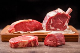 Photograph of a selection of finest butcher raw steak cuts.